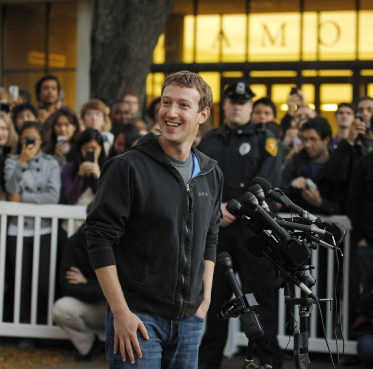 186953-facebook-founder-mark-zuckerberg-speaks-to-a-crowd-of-reporters-and-st